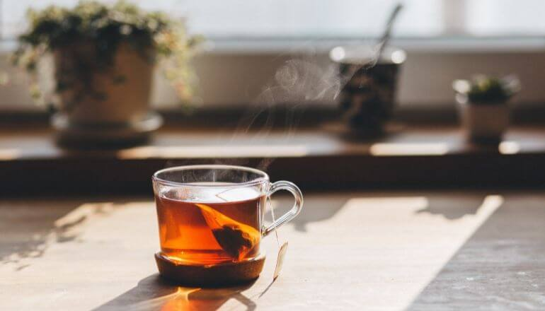 black tea in clear cup on counter