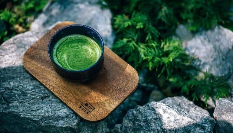 matcha green tea on wooden board