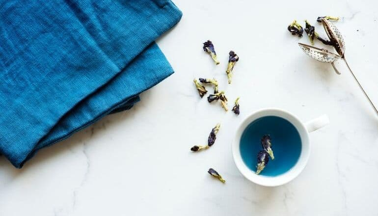 blue tea in a cup on table