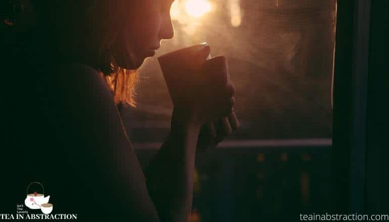 girl drinking tea at dusk