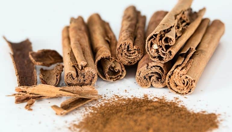 cinnamon on a white surface