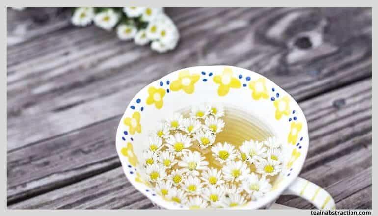 chamomile tea in white cup