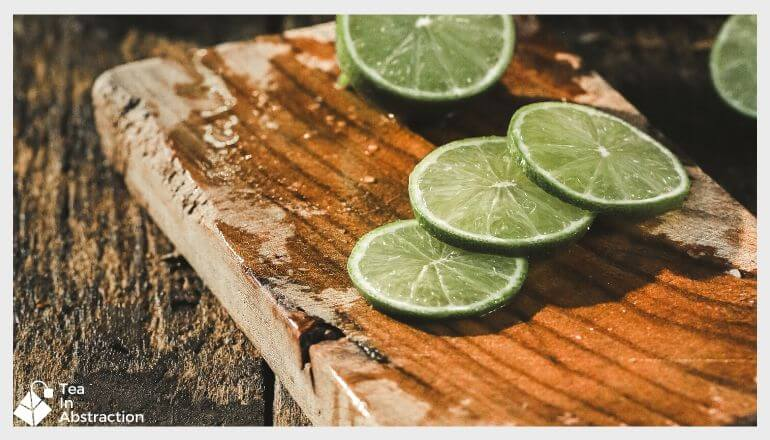 slices of fresh lime on a wooden cutting board