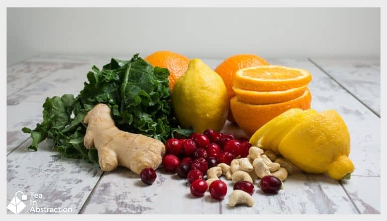 ginger lemon oranges and other vegetables on a table