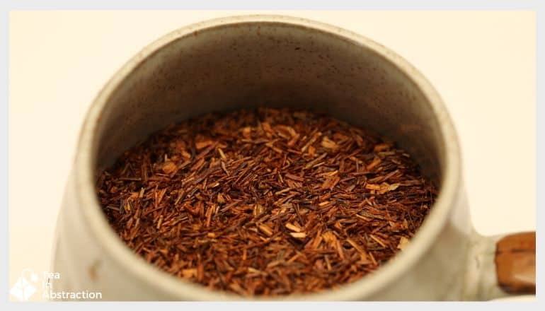 dried rooibos needles in a container for making tea