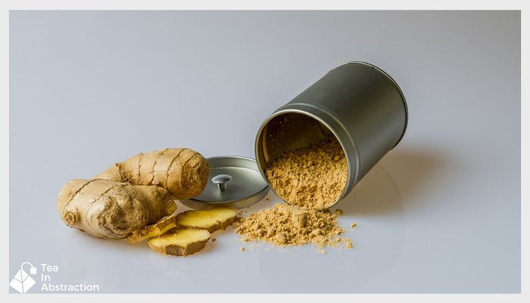 fresh cut ginger next to a tin of powdered ginger