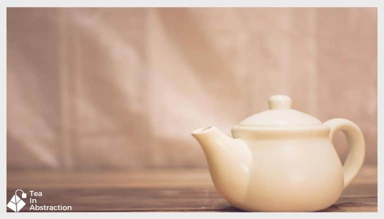 white tea kettle on a table