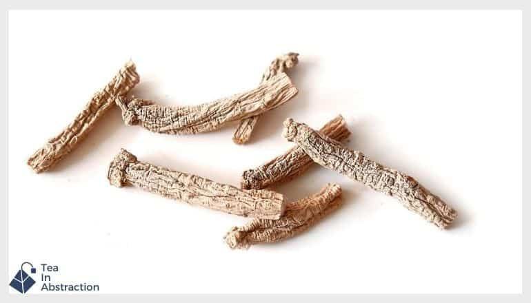 dried ginseng root against a white background