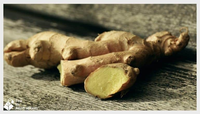 fresh cut ginger root on a wood table